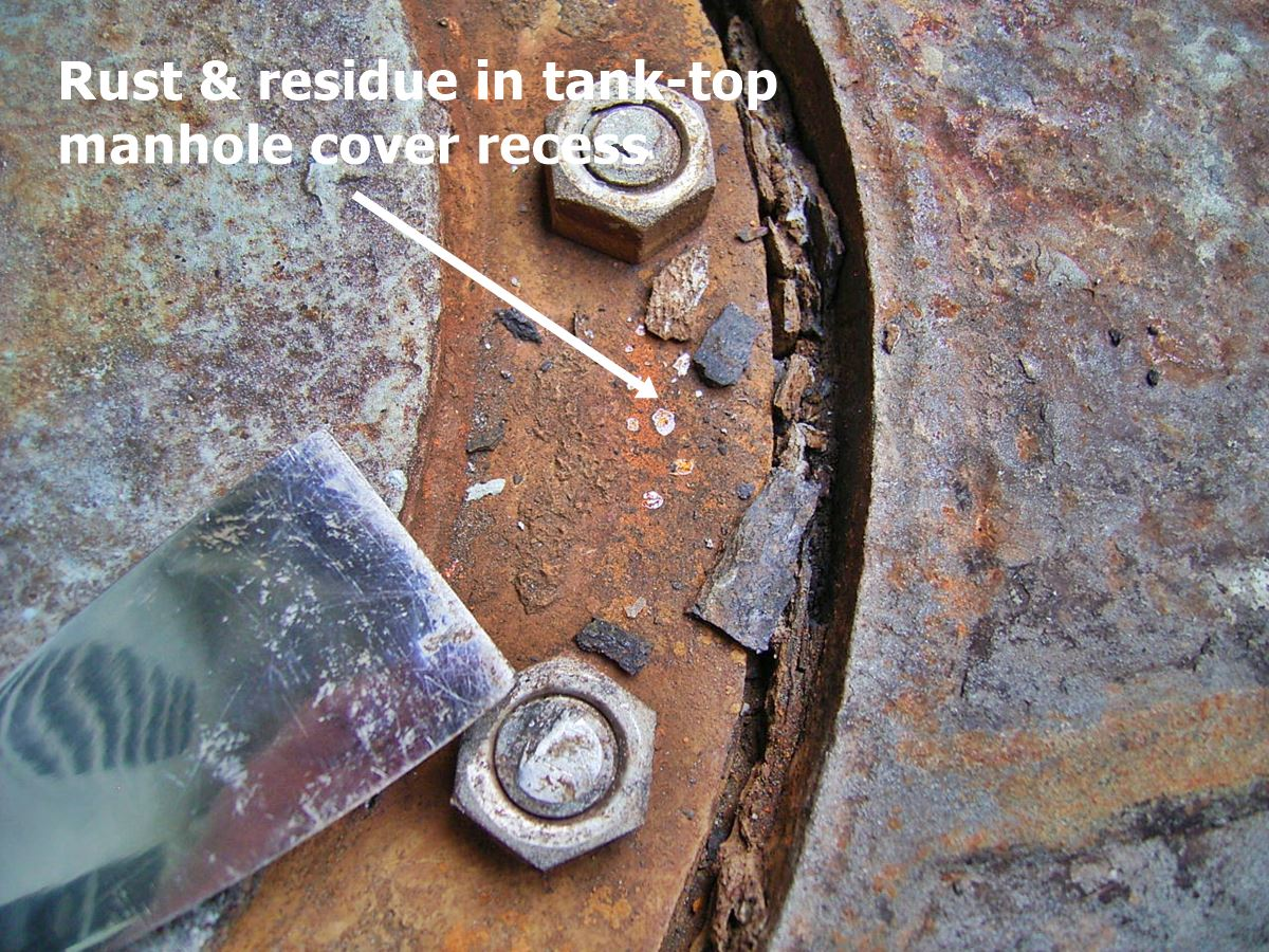 rust and debris in tanktop manhole cover recess